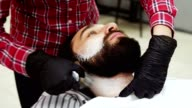 Barber applied to the face shaving foam by a swab video