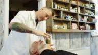 Barber Applying Shaving Cream video