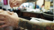Barber Bringing Straight Razor to Client's Face video