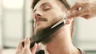 Barber cut a client's beard with clippers video