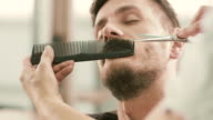 Barber cut a client's mustache with clippers video