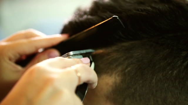 Barber makes hair part with clipper video