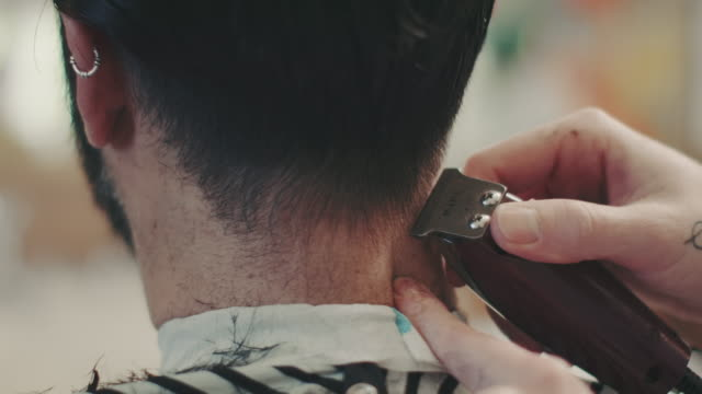 Barber making haircut with clipper video
