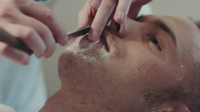 Barber shaving mans beard video