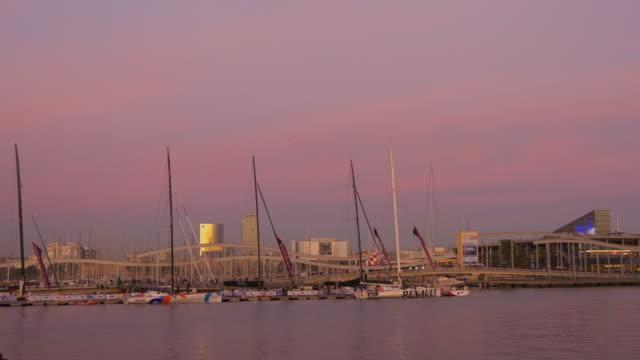 barcelona sunset light port vell boats dock 4k spain video