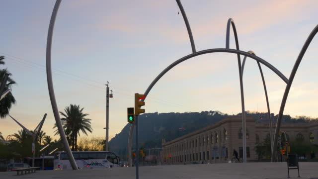 barcelona sunset light traffic circle metal monument 4k spain video