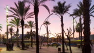 barcelona sunset palm port vell view metal sculpure 4k time lapse spain video