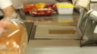 Barcode scanner at shopping cash register - Supermarket store groceries video