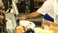 Barcode scanning groceries at shopping Store, supermarket video