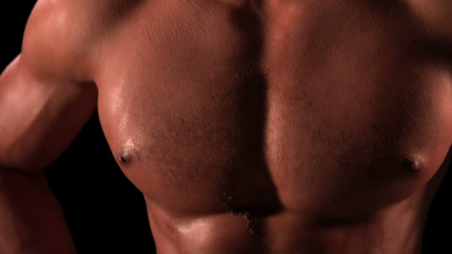 Bare chested male body builder with hands on hips, portrait video