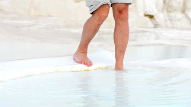 Bare feet in thermal water video