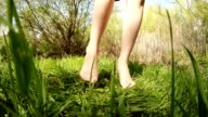 bare foot little girl dancing on the green grass video