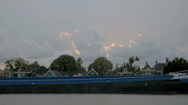 Barge sailing by the village houses video