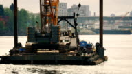 Barge Transporting Crane In City Harbor video