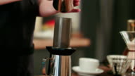 Barista adding grinded coffee and pouring hot water video