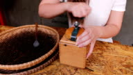 Barista grinding coffee by hand on a vintage coffee grinder video