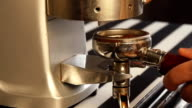 Barista grinds coffee slowmotion video