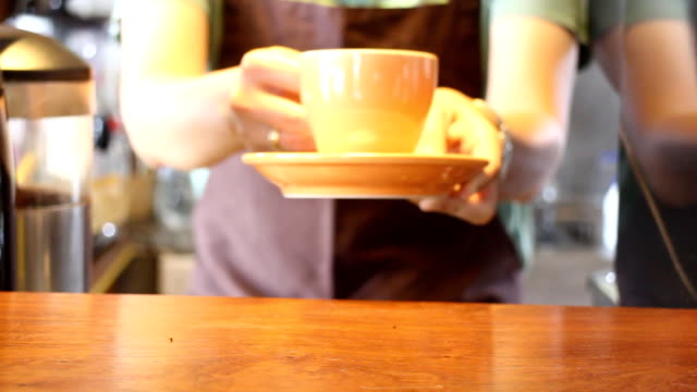Barista In Coffee Shop Serving Cup Of Espresso video