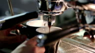 Barista makes coffee in the coffee machine. Black coffee mugs. video