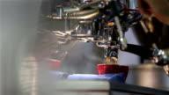 Barista makes coffee in the coffee machine. Red coffee mugs. video