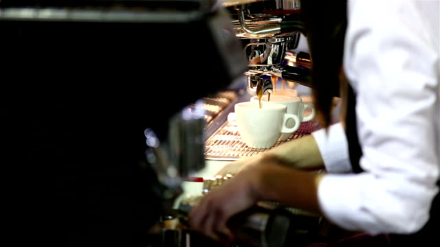 Barista makes coffee in the coffee machine. video