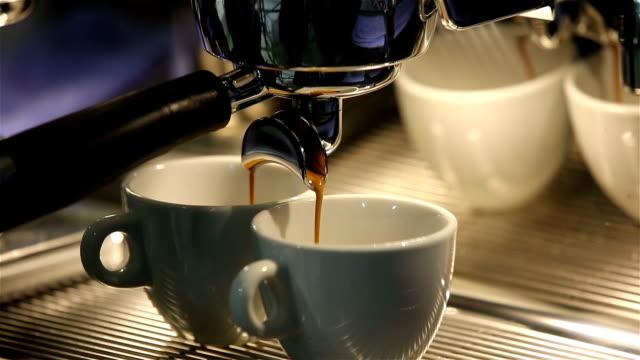 Barista makes coffee in the coffee machine. White coffee mugs. video