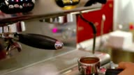 Barista makes latte coffees in coffee bar video