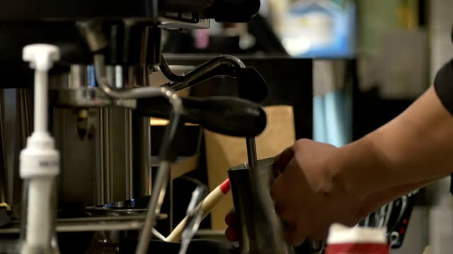 Barista making coffee with machine in cafe, slow motion. video