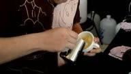 Barista making single shot of cafe latte art video