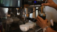 Barista making two of coffee latte in coffee bar video