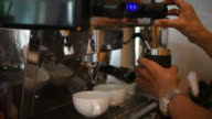 Barista making two of coffee latte in coffee bar. video