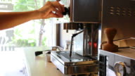 Barista open the coffee machine - slow motion video