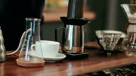Barista pouring water on coffee ground with filter video