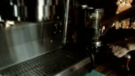 Barista pours ground coffee in holder coffee machine,  Close-up video