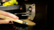 Barista prepares coffee in a cafe-bar, coffee grains video