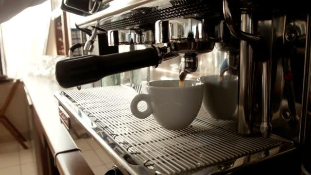 Barista prepares espresso in a coffee machine video