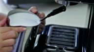 Barista steaming milk for a latte or cappuccino video