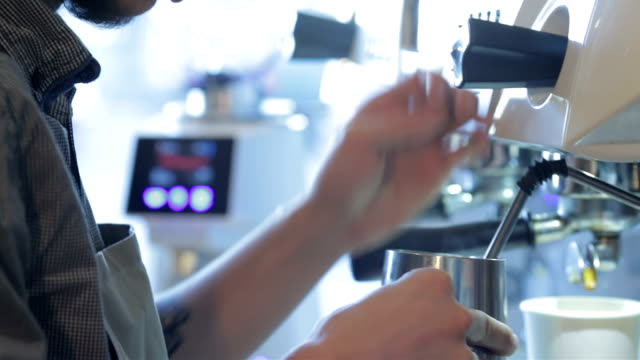 Barista steaming milk for hot cappuccino video