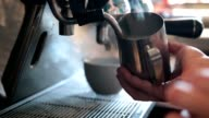 Barista steaming milk to prepare cappuccino video
