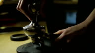 Barista tamping the grind coffee for espresso video