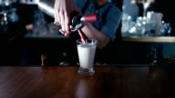 Barista whipping cream on a milk shake video
