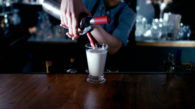 Barista whipping cream on a milk shake video