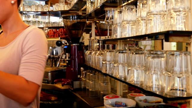 Barista Working In Coffee Shop (4K/UHD to HD) video