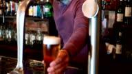 Barman filling beer from beer pump video