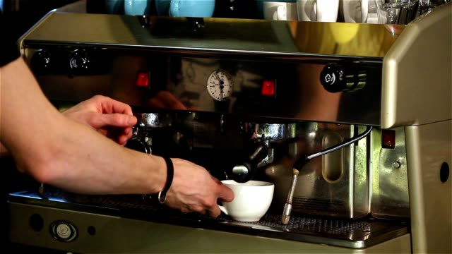 Barman making coffee, The bartender at the back face is not visible, Barista makes coffee, Interior bar video