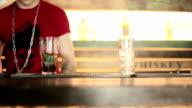 Barman mixes mint and berries pressure. video