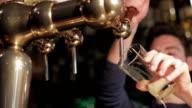 barman pours pint video