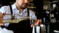 Barman prepares alcoholic cocktail in the bar video
