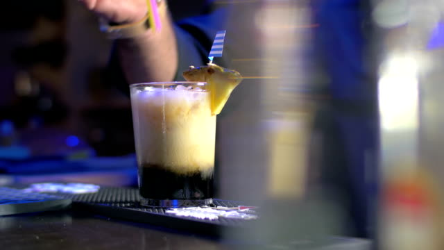 Barman Putting Straws into Glass with Cocktail video