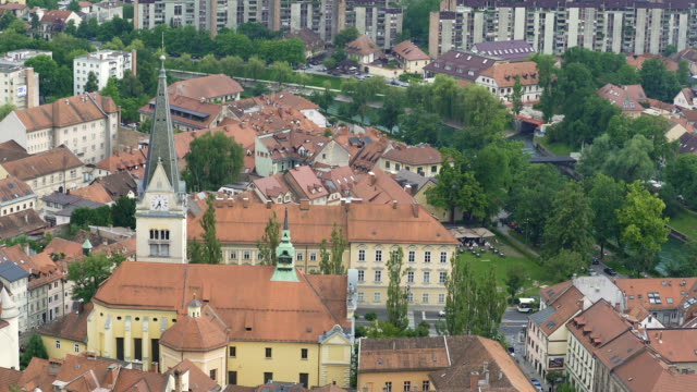 Baroque style church with gothic spire in Ljubljana downtown, tour to Slovenia video